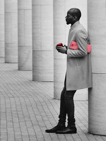 Man leaning against column